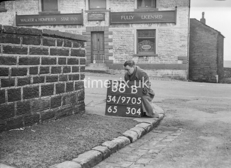 SD970538B, Man marking Ordnance Survey minor control revision point with an arrow in 1950s