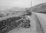 SD970729A, Man marking Ordnance Survey minor control revision point with an arrow in 1950s