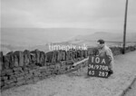 SD970810A, Man marking Ordnance Survey minor control revision point with an arrow in 1950s