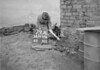 SD970679A, Man marking Ordnance Survey minor control revision point with an arrow in 1950s
