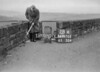 SD970528A, Man marking Ordnance Survey minor control revision point with an arrow in 1950s