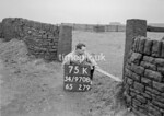 SD970875K, Man marking Ordnance Survey minor control revision point with an arrow in 1950s