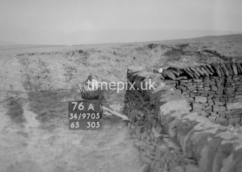 SD970576A, Man marking Ordnance Survey minor control revision point with an arrow in 1950s