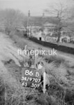 SD970786B, Man marking Ordnance Survey minor control revision point with an arrow in 1950s
