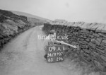 SD970709A, Man marking Ordnance Survey minor control revision point with an arrow in 1950s