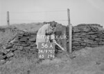 SD970756A, Man marking Ordnance Survey minor control revision point with an arrow in 1950s