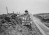 SD970746A, Man marking Ordnance Survey minor control revision point with an arrow in 1950s