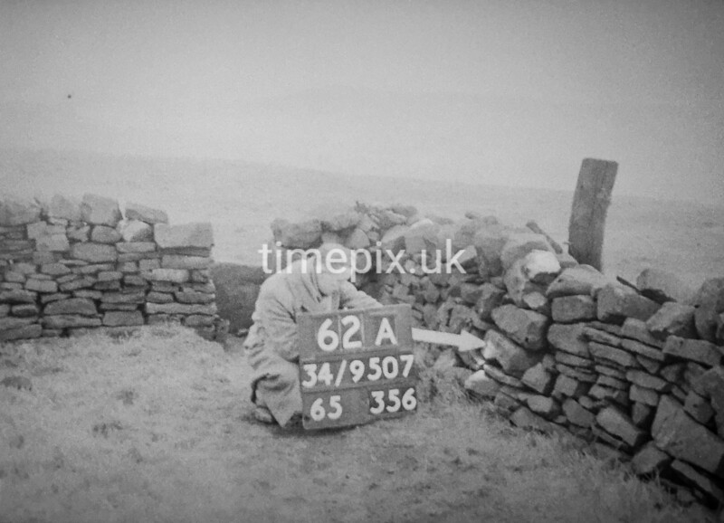 SD950762A, Man marking Ordnance Survey minor control revision point with an arrow in 1950s