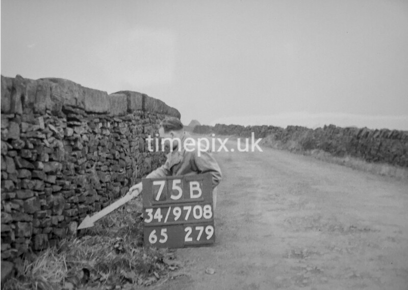 SD970875B, Man marking Ordnance Survey minor control revision point with an arrow in 1950s