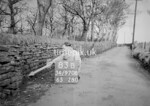 SD970883B, Man marking Ordnance Survey minor control revision point with an arrow in 1950s