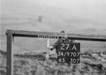 SD970727A, Man marking Ordnance Survey minor control revision point with an arrow in 1950s