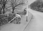 SD970873A, Man marking Ordnance Survey minor control revision point with an arrow in 1950s