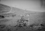 SD950781B, Man marking Ordnance Survey minor control revision point with an arrow in 1950s