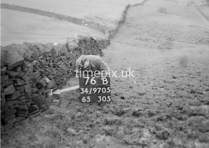 SD970576B, Man marking Ordnance Survey minor control revision point with an arrow in 1950s