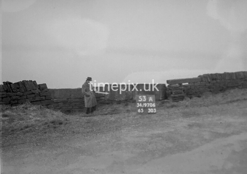 SD970653A, Man marking Ordnance Survey minor control revision point with an arrow in 1950s