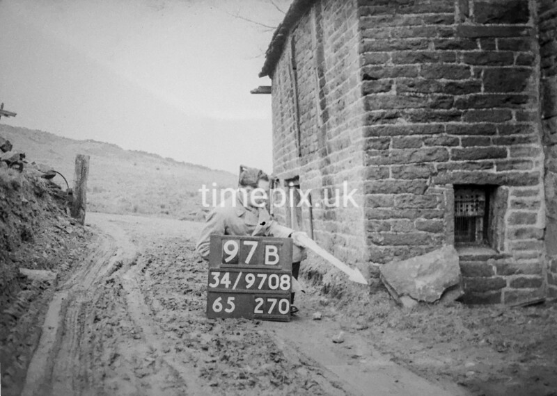SD970897B, Man marking Ordnance Survey minor control revision point with an arrow in 1950s