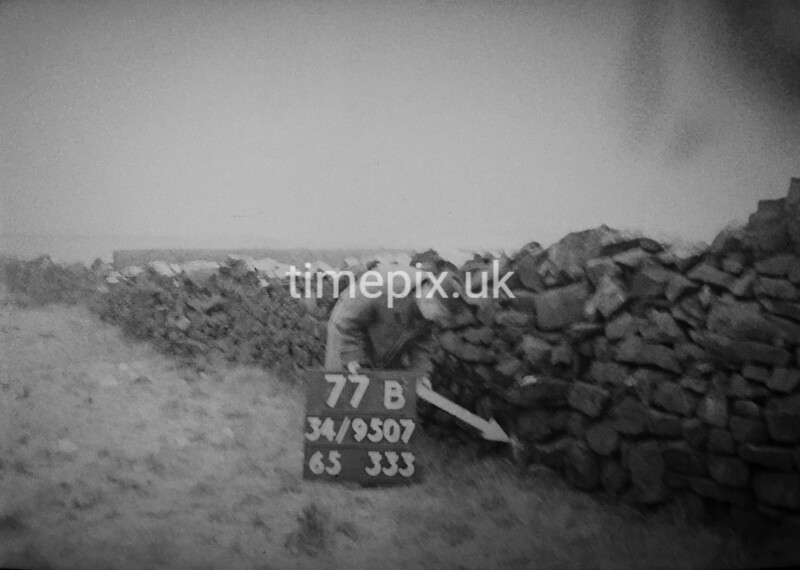 SD950777B, Man marking Ordnance Survey minor control revision point with an arrow in 1950s