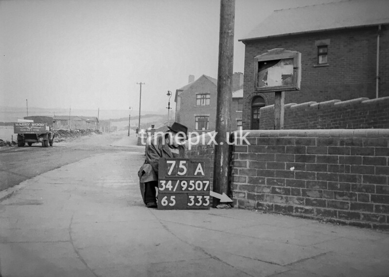 SD950775A, Man marking Ordnance Survey minor control revision point with an arrow in 1950s