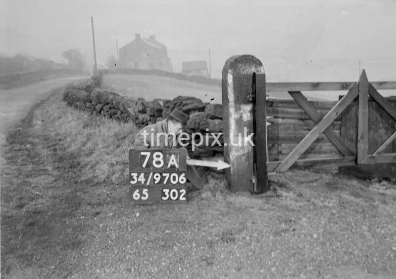 SD970678A, Man marking Ordnance Survey minor control revision point with an arrow in 1950s
