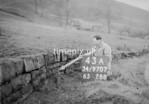 SD970743A, Man marking Ordnance Survey minor control revision point with an arrow in 1950s