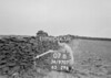 SD970707B, Man marking Ordnance Survey minor control revision point with an arrow in 1950s
