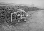 SD970875A, Man marking Ordnance Survey minor control revision point with an arrow in 1950s