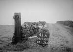 SD950741A, Man marking Ordnance Survey minor control revision point with an arrow in 1950s