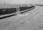 SD970534B, Man marking Ordnance Survey minor control revision point with an arrow in 1950s