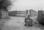 SD950504B, Man marking Ordnance Survey minor control revision point with an arrow in 1950s