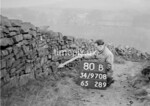 SD970880B, Man marking Ordnance Survey minor control revision point with an arrow in 1950s