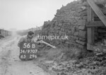 SD970756B, Man marking Ordnance Survey minor control revision point with an arrow in 1950s