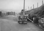SD970890A, Man marking Ordnance Survey minor control revision point with an arrow in 1950s