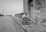 SD970801A, Man marking Ordnance Survey minor control revision point with an arrow in 1950s