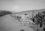 SD970845A, Man marking Ordnance Survey minor control revision point with an arrow in 1950s