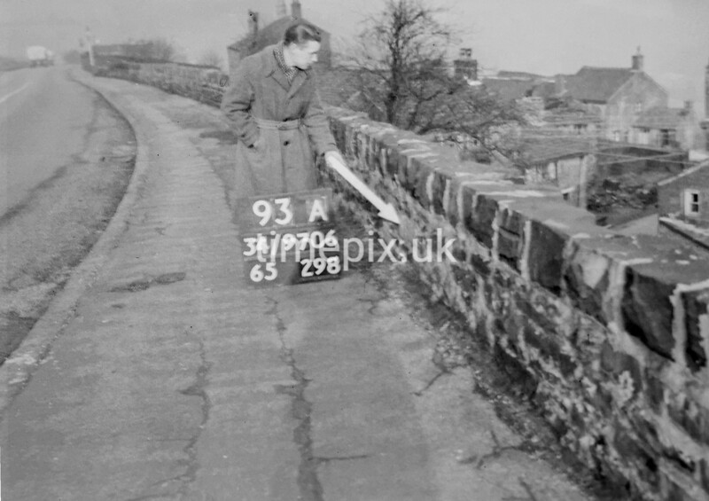 SD970693A, Man marking Ordnance Survey minor control revision point with an arrow in 1950s