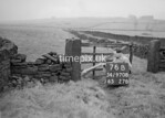 SD970876B, Man marking Ordnance Survey minor control revision point with an arrow in 1950s
