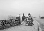 SD970796L, Man marking Ordnance Survey minor control revision point with an arrow in 1950s