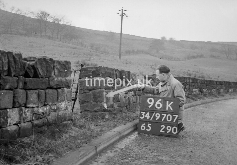 SD970796K, Man marking Ordnance Survey minor control revision point with an arrow in 1950s