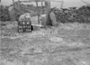 SD970516A, Man marking Ordnance Survey minor control revision point with an arrow in 1950s