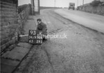 SD970693K, Man marking Ordnance Survey minor control revision point with an arrow in 1950s