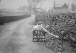 SD970875L, Man marking Ordnance Survey minor control revision point with an arrow in 1950s