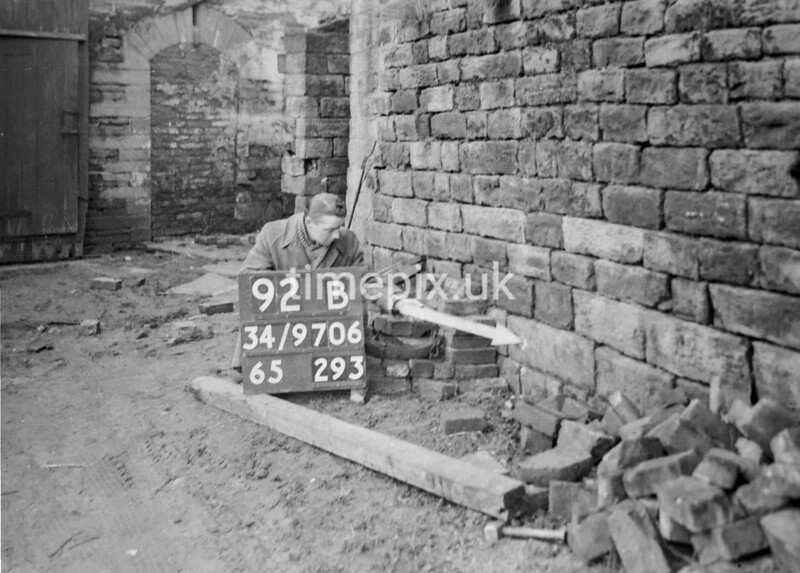 SD970692B, Man marking Ordnance Survey minor control revision point with an arrow in 1950s
