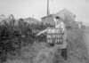 SD970784B, Man marking Ordnance Survey minor control revision point with an arrow in 1950s