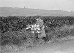 SD970665B, Man marking Ordnance Survey minor control revision point with an arrow in 1950s