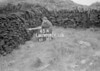 SD970645A, Man marking Ordnance Survey minor control revision point with an arrow in 1950s