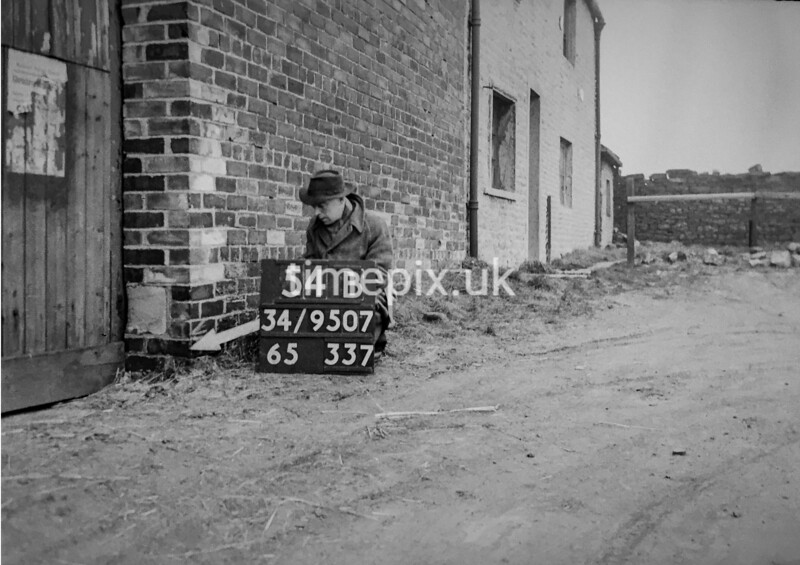 SD950754B, Man marking Ordnance Survey minor control revision point with an arrow in 1950s