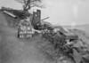 SD970692A, Man marking Ordnance Survey minor control revision point with an arrow in 1950s