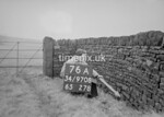 SD970876A, Man marking Ordnance Survey minor control revision point with an arrow in 1950s
