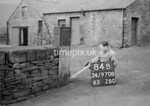 SD970884B, Man marking Ordnance Survey minor control revision point with an arrow in 1950s