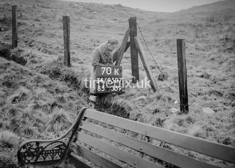 SD950770K, Man marking Ordnance Survey minor control revision point with an arrow in 1950s